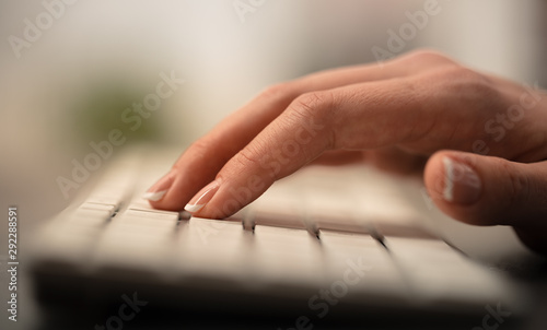 Fototapety, obrazy: Hand typing on keyboard with office concept