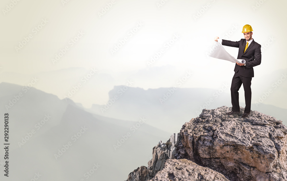 Fototapety, obrazy: Young business person on the top of the rock