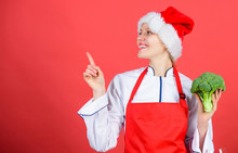 Festive Menu Concept. Christmas Dinner Ideas. Christmas Menu. Woman Chef Cooking Christmas Dinner Wear Santa Hat. Best Christmas Recipes. Enjoy Easy Ideas For Holiday Parties And Holiday Dinners