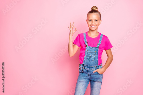 Valokuvatapetti Photo of cheerful cute nice preteen girl showing you ok sign approving your acti