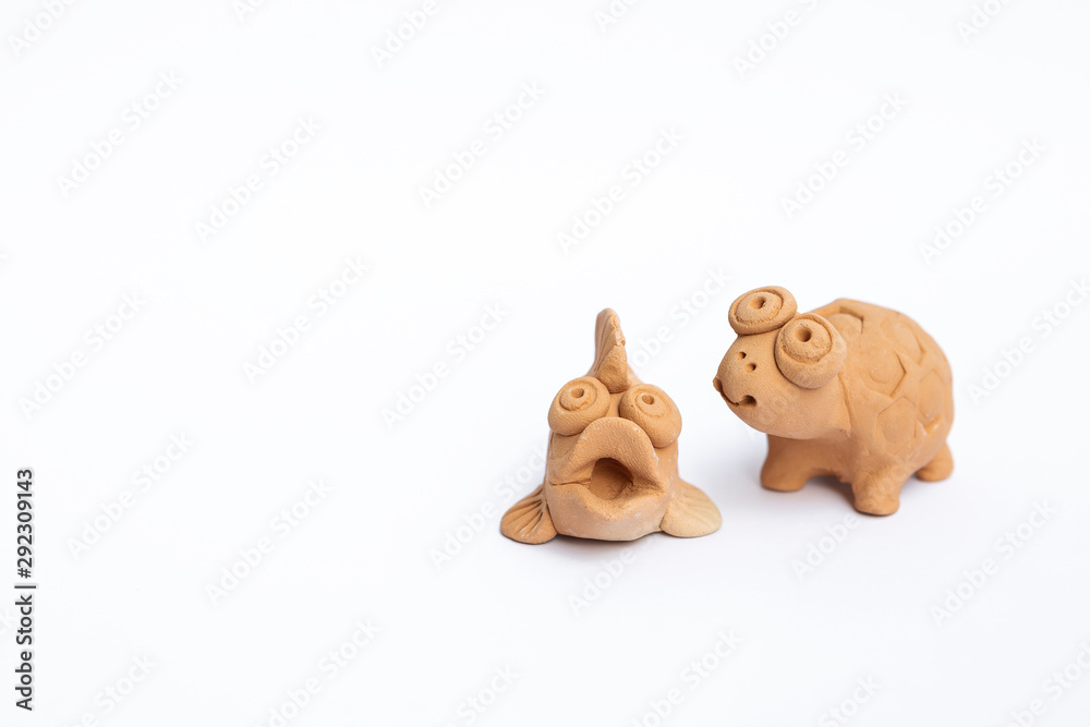 Fototapety, obrazy: Cute handmade little fish and turtle clay sculpture isolate on white background, garden decoration item