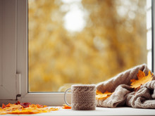 A Cup Of Hot Autumn Coffee Or Tea On The Window . The Concept Of Hygge. Hot Drink In Cold Autumn Weather