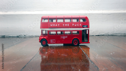 Door stickers London red bus toy bus on a wooden floor with a message