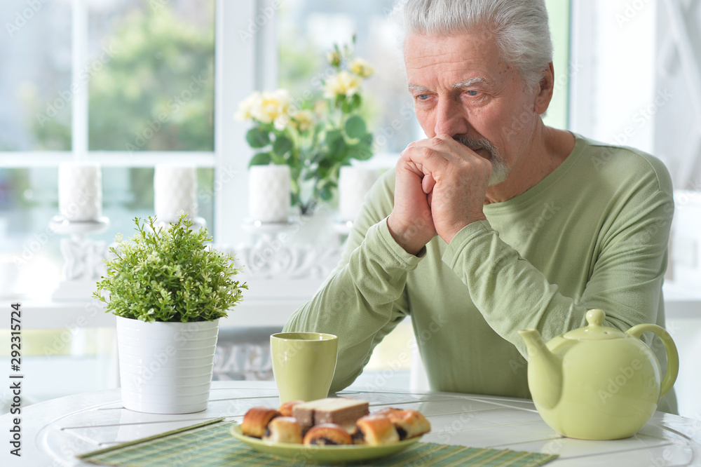 Fototapeta Portrait of elderly man drinking cup of coffee