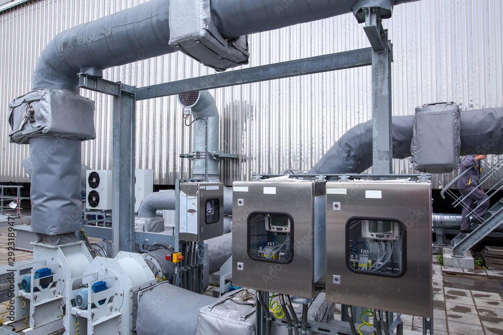 Fototapety, obrazy: External infrastructure of the microclimate support system at a large industrial site. Air pipelines inlet and exhaust. Fans and air conditioning. Systems of control of pressure, humidity, temperature