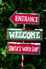 "North Pole Directional Sign Saying ""Entrance, Welcome, Santa's Workshop"""
