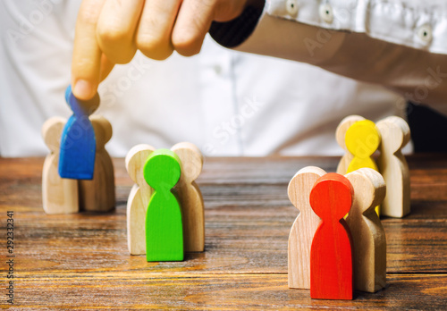 Groups of multicolored wooden people and businessman Fototapet