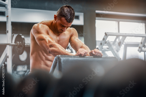 Handsome Muscular at the Gym during Bodybuilding Workout - 292337996
