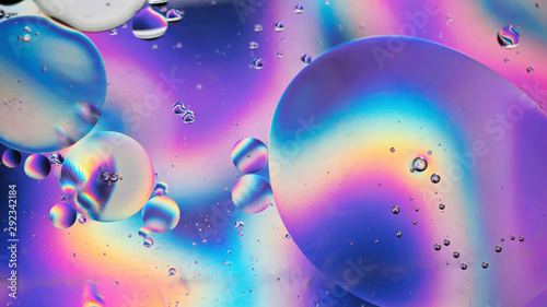 Oil drops in water. Abstract psychedelic pattern image rainbow colored. Abstract background with colorful gradient colors. DOF - 292342184
