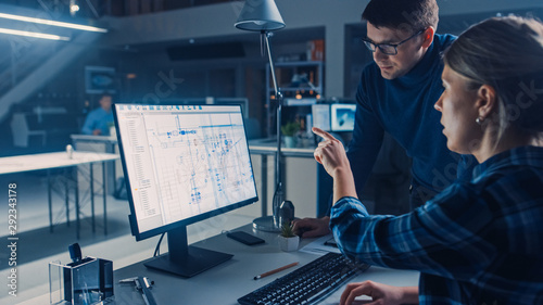 Obraz Engineer Working on Desktop Computer, Screen Showing CAD Software with Technical Blueprints, Her Male Project Manager Explains Job Specifics. Industrial Design Engineering Facility Office - fototapety do salonu