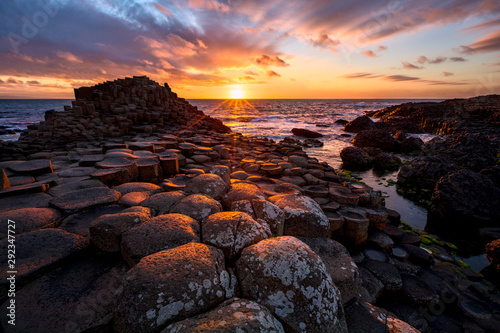 Fotomural sunset over basalt columns Giant's Causeway, County Antrim, Northern Ireland