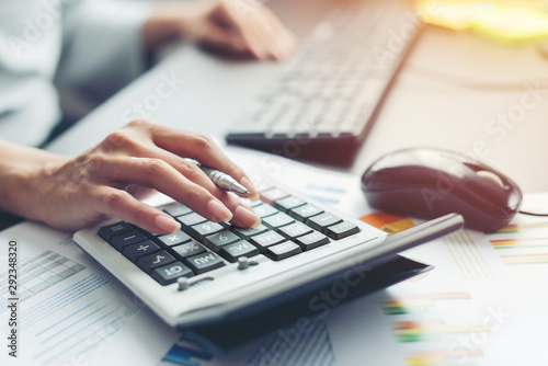 hand of business woman accountant or banker making calculations. Wallpaper Mural