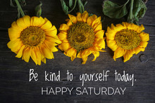 Inspirational Motivational Quote - Be Kind To Yourself Today. With 3 Beautiful Sunflowers On Rustic Wooden Table Background. Self Reminder, Happy Saturday Greeting Concept.
