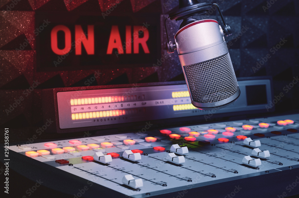 Fototapeta Professional microphone and sound mixer in radio studio