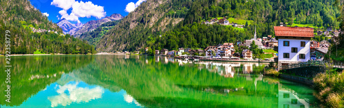 Wonderful lake Lago di Alleghe and beautiful village in Dolomites mountains, north of Italy