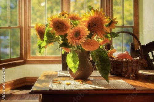 Fototapeta Still life with sunflowers in a vase on table obraz