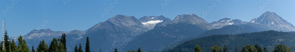 Fototapety, obrazy: Whistler Mountain Panorama in British Columbia, Canada in the summer sun and blue sky looking at mountain range