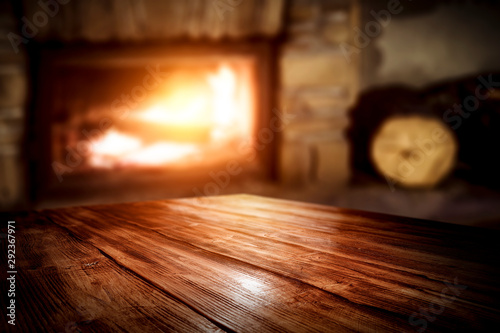 Fototapeta Wooden table and fireplace