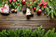 Flat Lay Christmas Border Background Of Twigs, Baubles And Handmade Decorations With Copy-space
