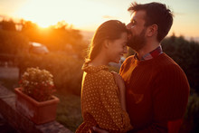 Romantic Man And Woman Kissing At Sunset.