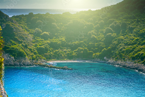 Photo sur Aluminium Olive Beautiful summertime panoramic seascape. Awesome view picturesque green slopes coastline sea with crystal clear azure water. Unique secluded beach.