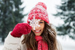 Leinwanddruck Bild - people, season and christmas concept - portrait of happy smiling teenage girl or young woman with snowflake in winter park
