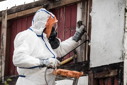 Photo team responsible for removing asbestos on a construction site