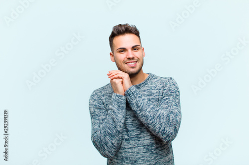 Fotografie, Obraz  young hispanic man feeling in love and looking cute, adorable and happy, smiling