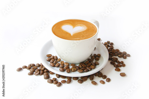 Fototapeta Coffee cup with latte art heart shape and beans isolated on a white background. obraz
