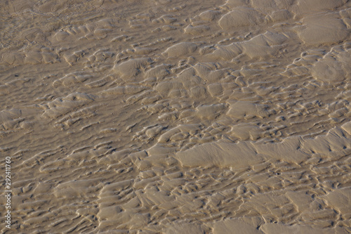 Tela Rippel und andere durch Wasserströmung verursachte Strukturen im Sandwatt