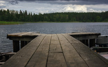 View Of The Forest Lake From A Wooden Pier