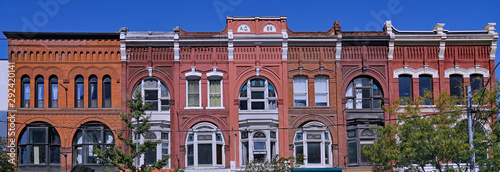 Fototapeta Block of ornate 19th century building facades in Toronto, Queen Street West, apartments above stores obraz