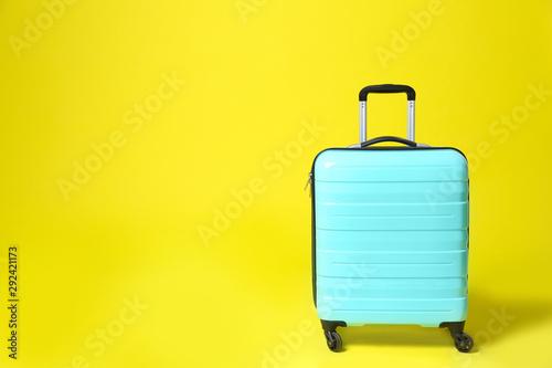 Stylish blue suitcase on yellow background. Space for text Billede på lærred