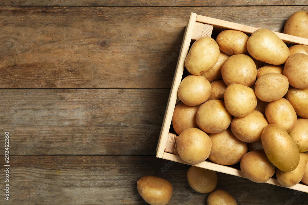 Fototapety, obrazy: Raw fresh organic potatoes on wooden background, top view. Space for text