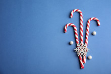 Candy Canes On Blue Background, Flat Lay. Space For Text