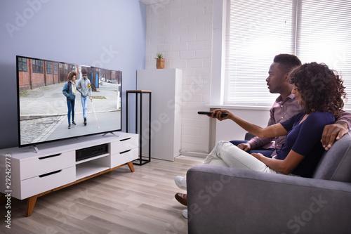 Fotografie, Obraz  Affectionate Family Watching TV