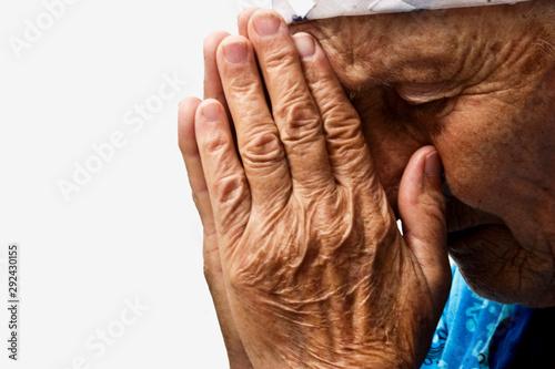 Old praying grandmother Fototapeta