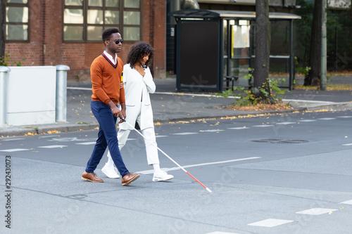 Fotografie, Tablou Woman Assisting Blind Man On Street