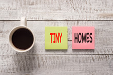 Handwriting Text Writing Tiny Homes. Conceptual Photo Houses Contain One Room Only Or Two And Small Entrance Cheap Stationary Placed Next To A Cup Of Black Coffee Above The Wooden Table