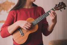 Young Girl Playing Ukulele Or ...