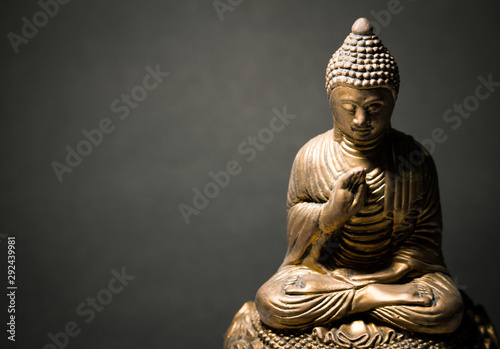 Stampa su Tela The statue of the Lord Buddha in Chinese style on a black background