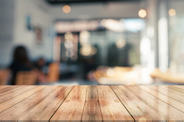 3D Rendering, Empty wooden table top with lights bokeh on blur restaurant background