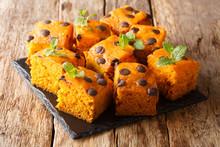 Organic Dessert Pumpkin Blondies With Chocolate Drops And Mint Closeup On A Slate Board. Horizontal