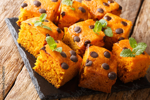 Halloween pumpkin blondies with chocolate drops and mint closeup on a slate board Wallpaper Mural