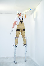 Painter In Stilts With Putty K...