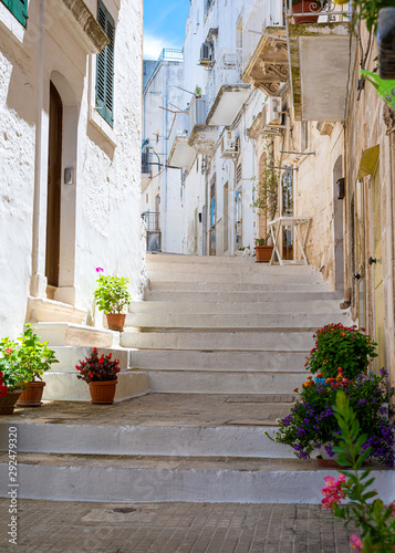 Printed kitchen splashbacks Narrow alley Scenic sight in Ostuni in a sunny summer day, Apulia (Puglia), southern Italy.
