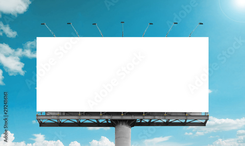 Obraz Mockup Large white blank billboard or white promotion poster displayed on the outdoor against the blue sky background. Promotion information for marketing announcements and details - fototapety do salonu