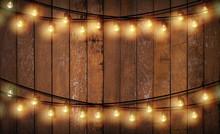 Light Bulb On Wooden Backgroun...