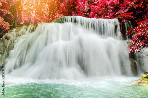 Foto auf Leinwand Forest river Travel to the beautiful waterfall in tropical rain forest, soft water of the stream in the natural park at Huai Mae Khamin Waterfall in Kanchanaburi, Thailand.