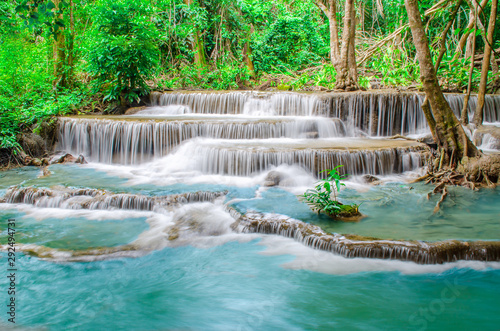 Foto auf Gartenposter Forest river Travel to the beautiful waterfall in tropical rain forest, soft water of the stream in the natural park at Huai Mae Khamin Waterfall in Kanchanaburi, Thailand.